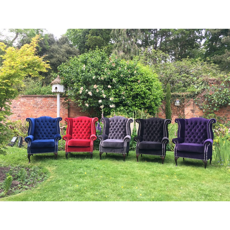 Red velvet wingback chairs